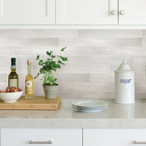 Timber Tile Peel & Stick Backsplash-back-splash resembles timber tiles. With light neutral and white hues, used as back-splash back of kitchen counters.