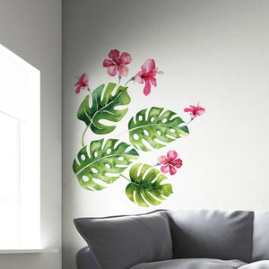 Tropical Wall Decal-vivid green palm fronds and pink hibiscus flower decals with a watercolor design.  Hung in corner over sofa