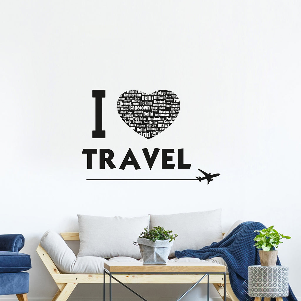 Travel Wall Quote-Its collage of major cities and black and white hues give this wall quote decal a contemporary edge.  I travel is printed in black with plane soaring underneath.  Hung on wall above couch