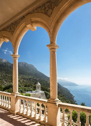 Mallorca Island Wall Mural-The glorious view of the sea through an arched veranda with a clear blue sky.