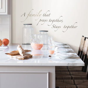Pray Together Wall Quote-A family that prays together, Stays together. With a beautiful script font and stylish brown hues, hung on kitchen wall