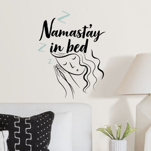 Namast'ay in Bed Wall Quote-This wall quote, which is written in black, Namast'ay in bed, is complete with pale blue Zs and a slumbering beauty.  Hung on wall over bed
