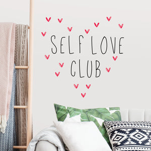 Self Love Club Wall Quote-quote-self love club printed in black surrounded by small pink hearts. hung in living room