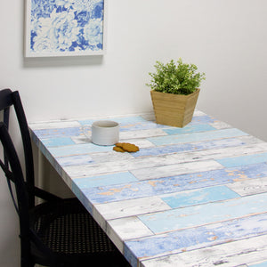 Scrapwood Adhesive Film's beautifully weathered design and scrap wood peel and stick liner.  Shown on kitchen table
