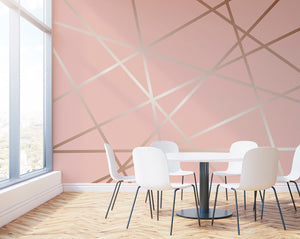 Rose Pinnacle Wall Mural-lines of rose gold shine bright against a soft pink background in geometric shapes. hung in dining room