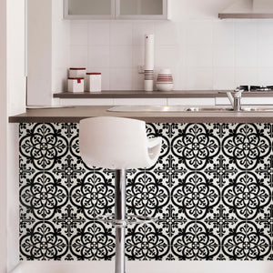Avignon Peel & Stick Backsplash is a black and white gothic tile that is put in front of kitchen counter