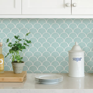 Shell Peel & Stick Backsplash Tiles-The shell design has an inviting seafoam finish.   Used as backsplash under kitchen cupboards