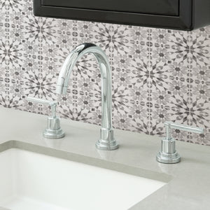 Catalan Peel & Stick Backsplash with its soft grey and charcoal hues in geometrical shape.  Used as backsplash behind sink.