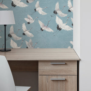 Halcyon Peel & Stick Wallpaper he hand-painted cranes look picturesque flying over a marbled blue background.  Hung on wall with desk in front.