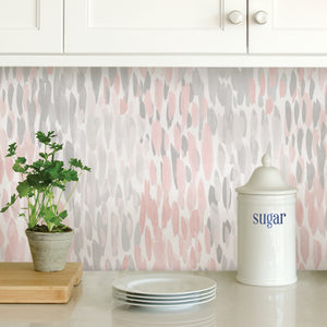 Blush Make It Rain Peel & Stick Wallpaper-grey and blush watercolor give it a rainfall pattern.  Used as a back splash under kitchen cupboards.