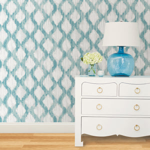 Teal Floating Trellis Peel & Stick Wallpaper-watercolor style, this trellis design has a teal and grey pattern.  Hung on wall in bedroom