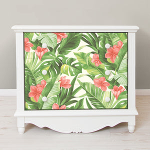 Tropical Paradise Peel & Stick Wallpaper-Coral flowers bloom among banana and palm leaves.  Used on the front of a 2 drawer dresser