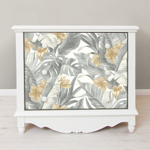 Neutral Paradise Peel & Stick Wallpaper-Palm fronds, banana leaves, and flowers are given a neutral spin in grey and tan. gives it a tropical flare.  Used on front of dresser drawers
