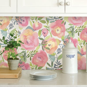 Peachy Keen Pink Peel & Stick Wallpaper-Peach and pink flowers with curling green leaves pop against a white background.  used in kitchen as backsplash