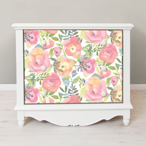 Peachy Keen Pink Peel & Stick Wallpaper-Peach and pink flowers with curling green leaves pop against a white background.  Used on front of dresser drawers