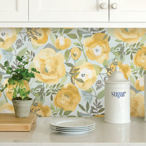 Peachy Keen Yellow Peel & Stick Wallpaper-n a watercolor style, mustard and yellow flowers flutter about curling leaves and an icy seafoam background.  used as kitchen backsplash