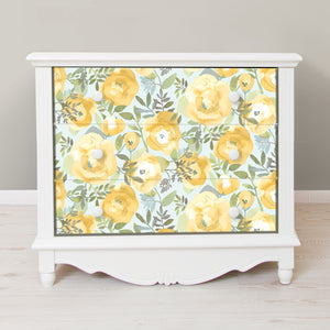 Peachy Keen Yellow Peel & Stick Wallpaper-n a watercolor style, mustard and yellow flowers flutter about curling leaves and an icy seafoam background.  used on the front drawers of a dresser
