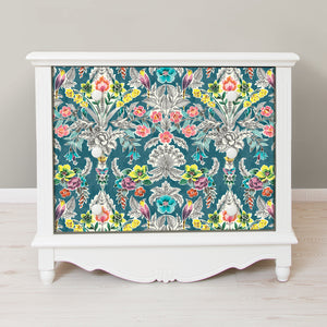 Summer Love Teal Peel & Stick Wallpaper-botanical damasks comprised of yellow birds, coral flowers, and green roses pop against a rich teal background.  used on front of 3 drawer dressser