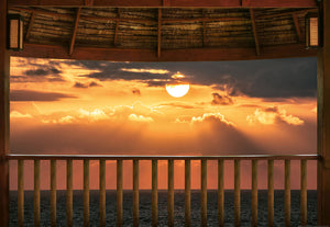Ocean View Terrace At Sunset Wall Mural-beach sunset with orange light streaks peaking through fluffy clouds.