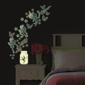 Fairy Dust Glow in the Dark Wall Art Kit -peel and stick wall paper pixie dust, these green and blue glow in the dark fairy decals also includes stars and butterflies.  Shown glowing at night.