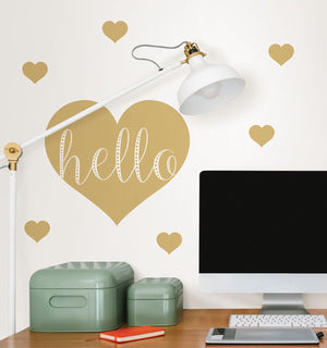 Hello Wall Quote-this peel and stick quote hello is written in white inside a large gold heart with 6 smaller gold hearts around the outside.  Hung on wall over computer desk.