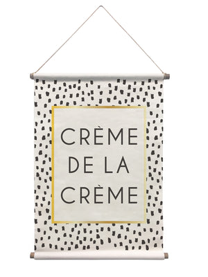 Creme De La Creme Wall Tapestry has black speckled design and gold accents