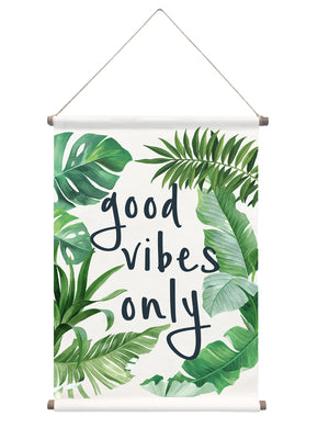 Good Vibes Wall Tapestry Palm has fronds and banana leaves that frame  good vibes only quote which is written in black.