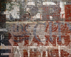 Warehouse Brick Wall Mural-look of a faux brick wall with vintage text.