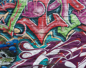 Urban Graffiti Wall Mural-colorful and intricate graffiti painted over a brick wall.