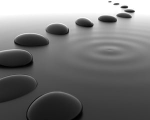 Pebbles Wall Mural-A black and white depiction of zen stones in water.