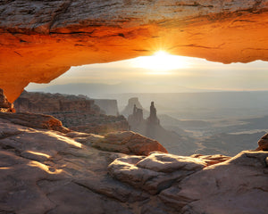 Canyonlands National Park Wall Mural-sun rises over desert landscape.