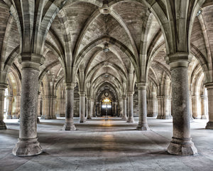 Gothic Arches Wall Mural- number of arches lead to light in distance.
