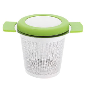 stainless steel tea strainer with green lid and handles