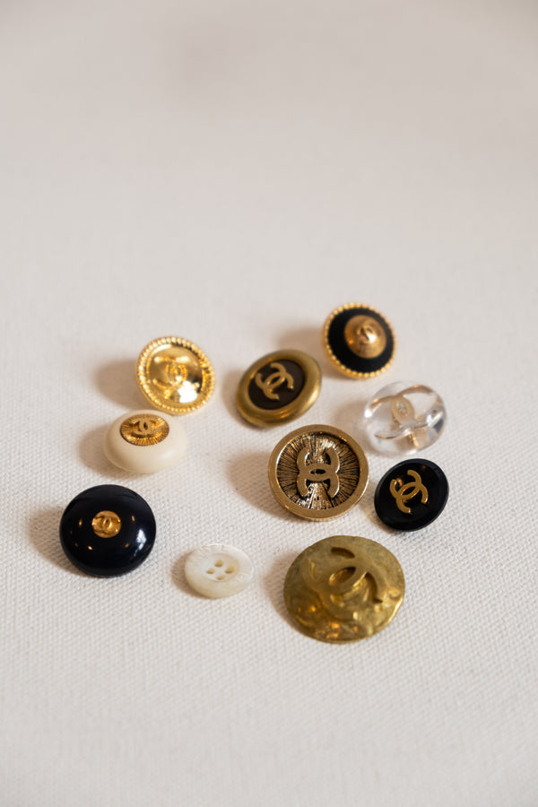 Chanel, Set of 9 Vintage Gold, Lucite, and Black Enamel Buttons