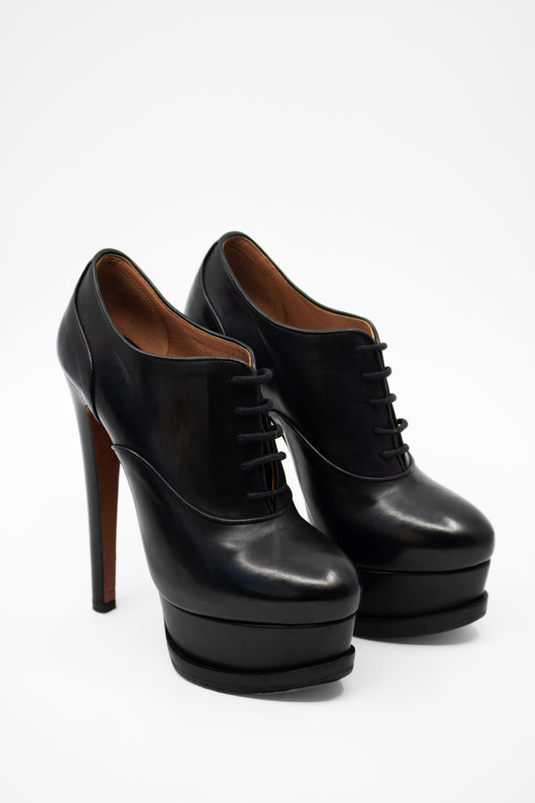 Alaïa Lace-Up Platform Booties