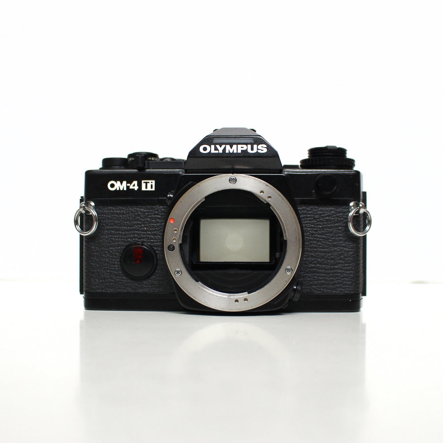 OLYMPUS OM-4 Ti (Mint Condition) [Kit] Om-System G.Zuiko 50mm f/1.4 + Olympus T32 flash + Power Winder