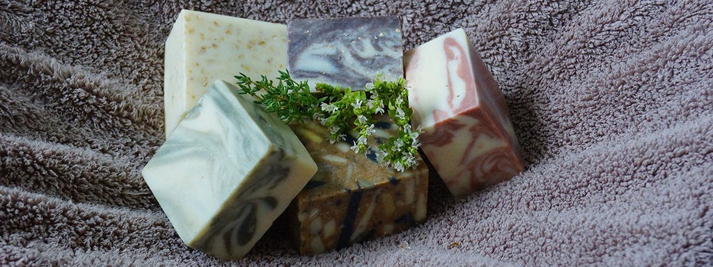 Block marbled soaps on a towel