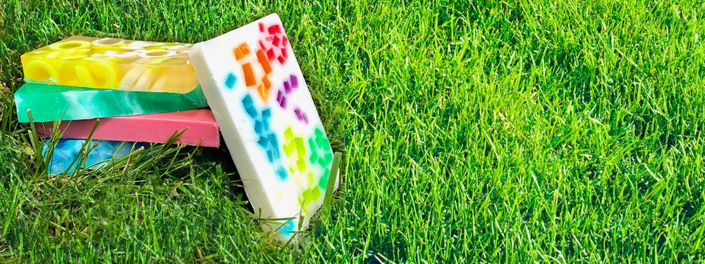 A stack of colorful glycerin soaps on grass