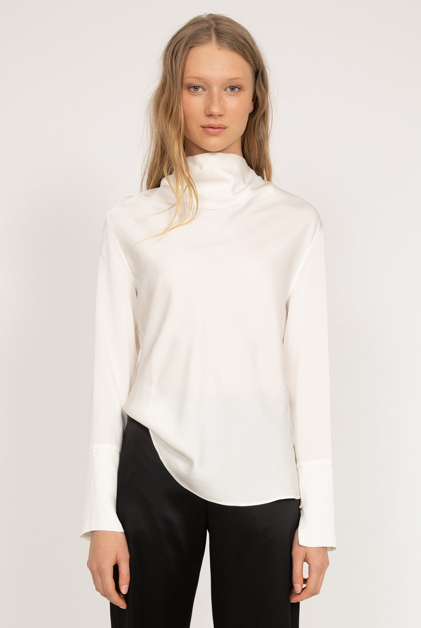 Ahlvar Gallery Ayumi Blouse in Off White with long sleeves and a draped, bias-cut front