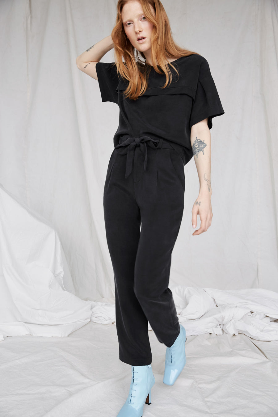 Eve Gravel Lions Eco Pants in Black with a relaxed fit and self-tie belt