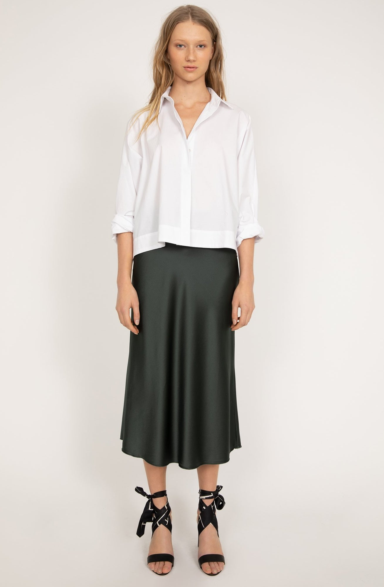 Ahlvar Gallery Gigi Shirt in White with an oversized, button-up fit crafted of cotton poplin.