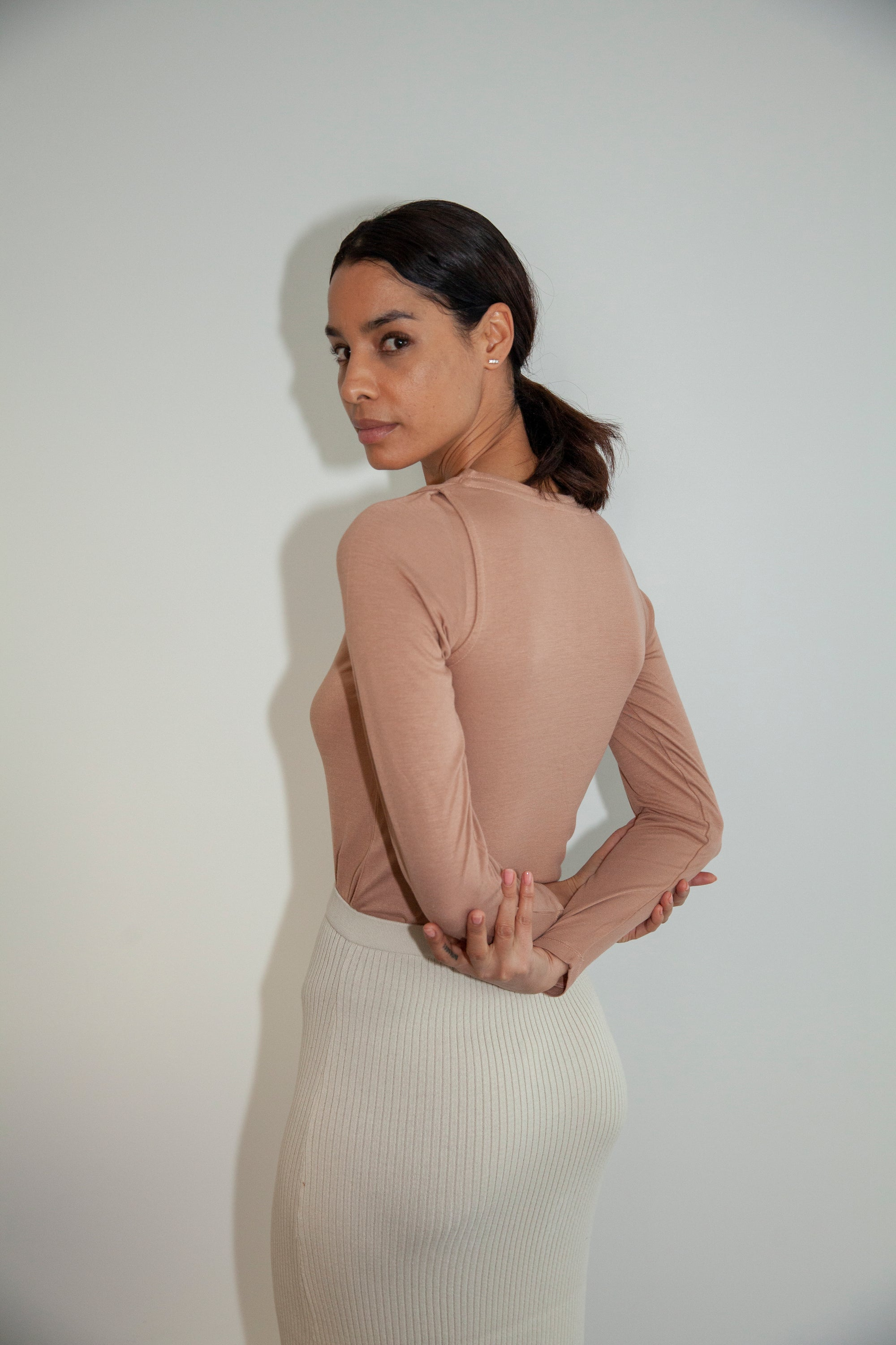 By Signe Yakamoz Blouse in Brown with a crewneck and button placket