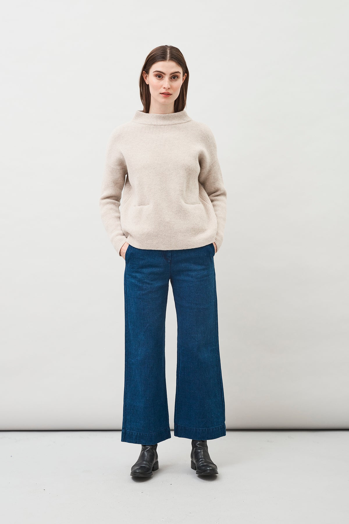 Helga Wool Sweater in Oat in a rib-knit construction with a chimney collar and integrated pockets