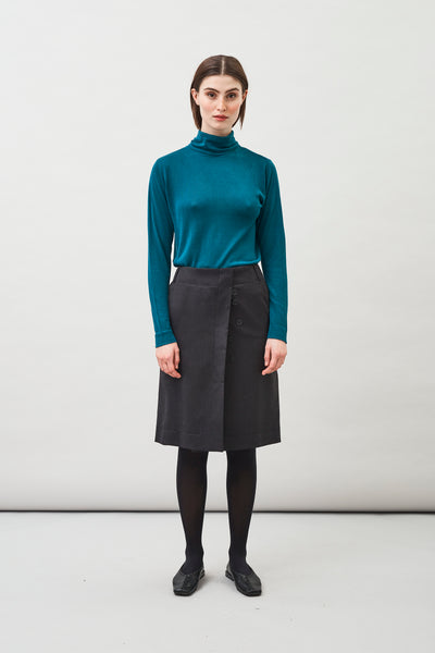 Loka Roll Neck Sweater in Peacock Blue cut from an exclusive silk-cashmere yarn
