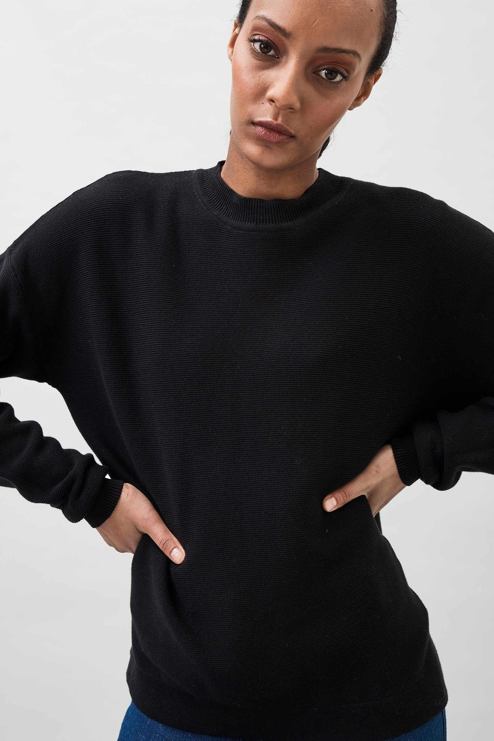Nela Garter Stitch Organic Cotton Sweater with a slightly oversized fit and ribbed crewneck.
