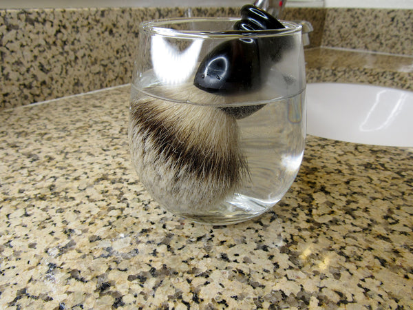 How to clean your shave brush set up: warming the brush in a container