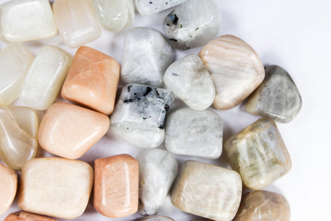 varieties of moonstone, pink moonstone, blue moonstone, black moonstone, white moonstone, healing crystals, tumbled