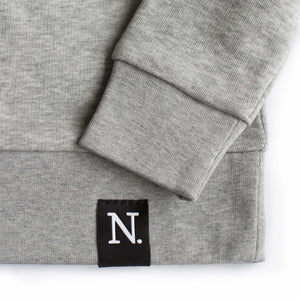 The Number 5 grey sweatshirt detail