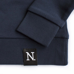 The Number 3 navy sweatshirt detail