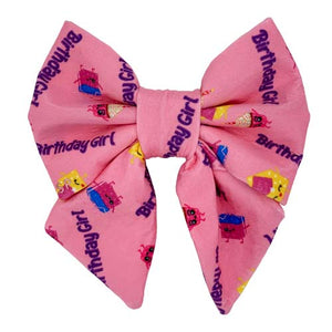 Fun Pink Birthday Girl Dog Sailor Bow from Swanky Paws with cupcakes and little presents on it
